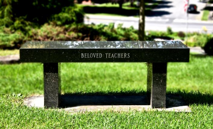 [Image: A lovely bench monument with custom etch work. ]